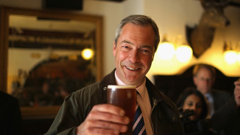 SOUTH SHIELDS, ENGLAND - APRIL 30:  UK Independence Party (UKIP) Leader Nigel Farage enjoys a pint of beer after canvassing with the party's local candidate for South Shields on April 30, 2013 in South Shields, England.  (Photo by Christopher Furlong/Getty Images)