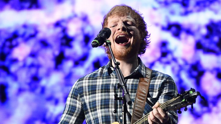 Ed Sheeran performs onstage at the Rock in Rio USA music festival at the MGM Resorts Festival Grounds in Las Vegas, Nevada on May 15, 2015. AFP PHOTO / ROBYN BECK (Photo credit should read ROBYN BECK/AFP via Getty Images)