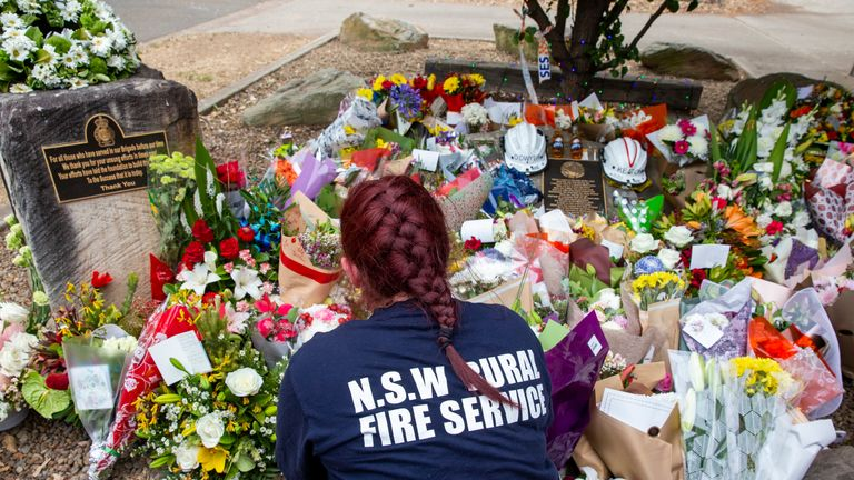 SYDNEY, AUSTRALIA - DECEMBER 22: Tributes for volunteers Geoffrey Keaton and Andrew O'Dwyer are seen at Horsley Park Rural Fire Brigade on December 22, 2019 in Sydney, Australia. The men died when their truck overturned near the town of Buxton late on Thursday when a tree fell into their path. A catastrophic fire danger warning has been issued for the greater Sydney region, the Illawarra and southern ranges as hot, windy conditions continue to hamper firefighting efforts across NSW. NSW Premier Gladys Berejiklian declared a state of emergency on Thursday, the second state of emergency declared in NSW since the start of the bushfire season. (Photo by Jenny Evans/Getty Images)