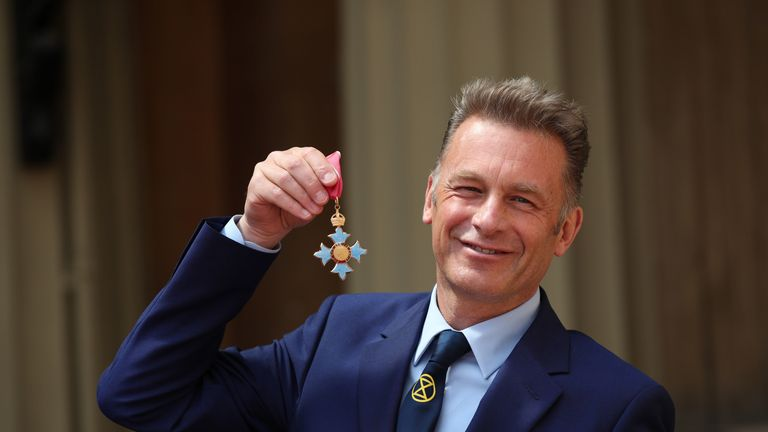 LONDON, ENGLAND - MAY 16: Chris Packham poses with his CBE following an investiture ceremony at Buckingham Palace on May 16, 2019 in London, England. (Photo by Yui Mok - WPA Pool/Getty Images)