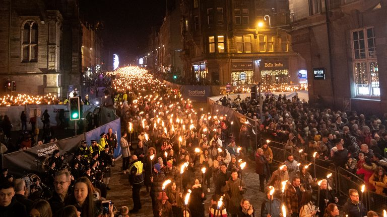 Members of the public take part in the annual torchlight procession as it makes its way along Edinburgh's Royal Mile towards Holyrood Park for the start of the Edinburgh Hogmanay celebrations.
