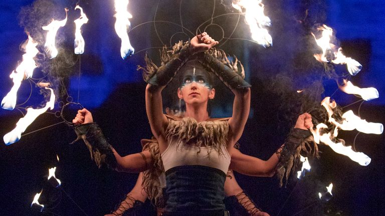 The Celtic Fire Theatre company PyroCeltica perform in front of Edinburgh Castle ahead of a torchlit procession down the Royal Mile during Edinburgh Hogmanay celebrations.