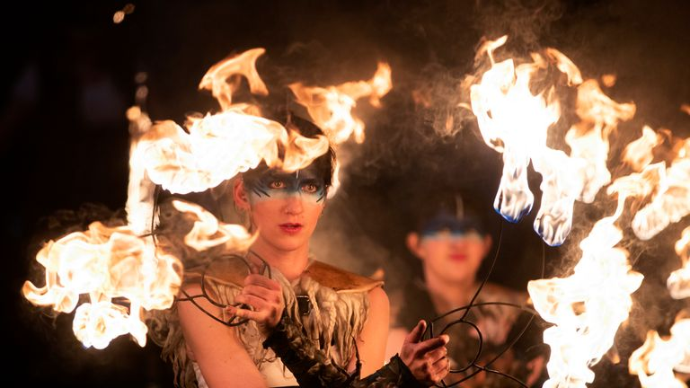 The Celtic Fire Theatre company PyroCeltica lead the annual torchlight procession as it makes its way along Edinburgh's Royal Mile towards Holyrood Park for the start of the Edinburgh Hogmanay celebrations.