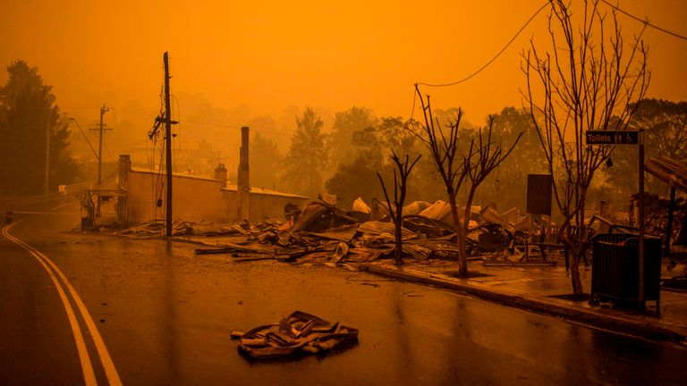 The remains of burnt out buildings are seen along main street in the New South Wales town of Cobargo on December 31, 2019, after bushfires ravaged the town. - Thousands of holidaymakers and locals were forced to flee to beaches in fire-ravaged southeast Australia on December 31, as blazes ripped through popular tourist areas leaving no escape by land. (Photo by SEAN DAVEY / AFP) (Photo by SEAN DAVEY/AFP via Getty Images)