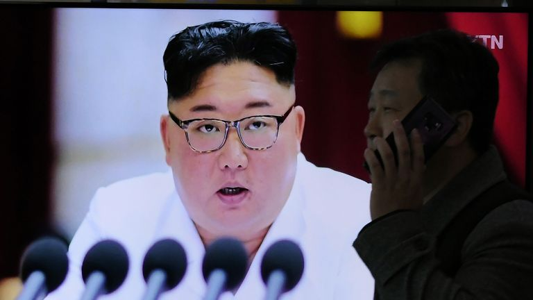 "A man walks past a television news program showing the latest pictures of North Korean leader Kim Jong Un, at a railway station in Seoul on December 30, 2019. - North Korean leader Kim Jong Un has called for ""offensive measures"" to strengthen security ahead of a New Year speech that could flesh out the nuclear-armed nations threat to seek a ""new way"" forward after the expiration of its year-end deadline for US sanctions relief. (Photo by Jung Yeon-je / AFP) (Photo by JUNG YEON-JE/AFP via Getty Images)"