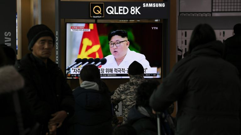 """People watch a television news program showing the latest pictures of North Korean leader Kim Jong Un, at a railway station in Seoul on December 30, 2019. - North Korean leader Kim Jong Un has called for """"offensive measures"""" to strengthen security ahead of a New Year speech that could flesh out the nuclear-armed nations threat to seek a """"new way"""" forward after the expiration of its year-end deadline for US sanctions relief. (Photo by Jung Yeon-je / AFP) (Photo by JUNG YEON-JE/AFP via Getty Images)"""