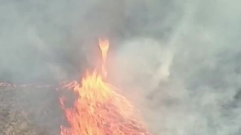 Authorities in Queensland issued an emergency warning when a grass fire, sparked by a building blaze, rapidly advanced across dry grassland