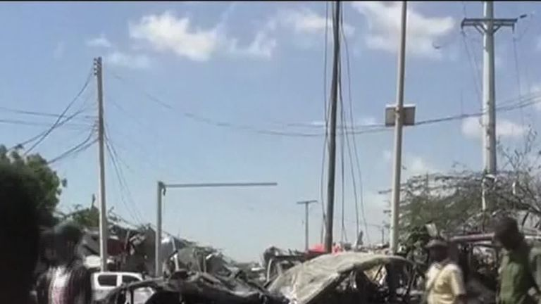 A car bomb outside a tax collection centre in Somalia has killed at least 60 people, according to local officials.