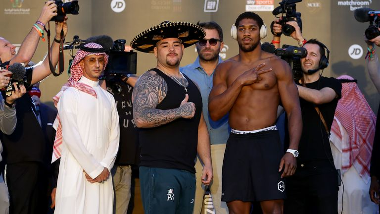 Andy Ruiz Jr (L) and Anthony Joshua (R) pose for photos after weighing in