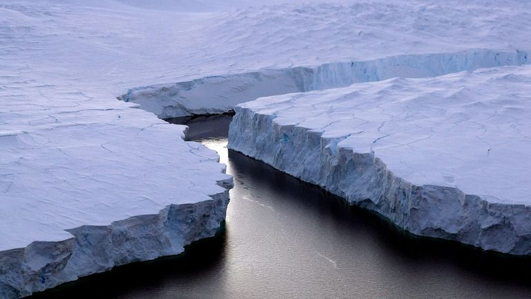 An enormous iceberg (R) breaks off the Knox Coast in the Australian Antarctic Territory