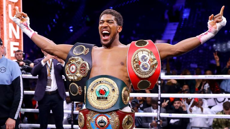 Anthony Joshua celebrates his victory