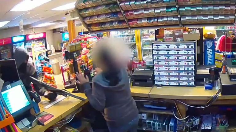 Investigators are asking the public for help to identify the suspects and the clerk was not hurt.