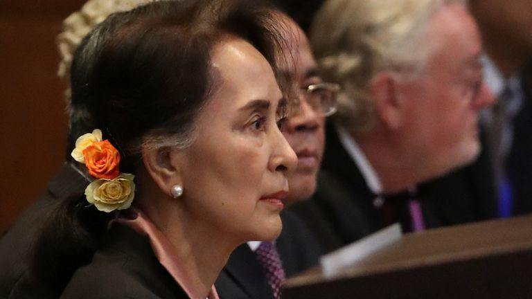 Aung San Suu Kyi sits inside the International Court of Justice