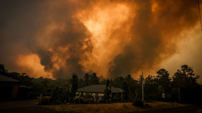 Two bushfires approached a home on the outskirts of the town of Bargo in Sydney