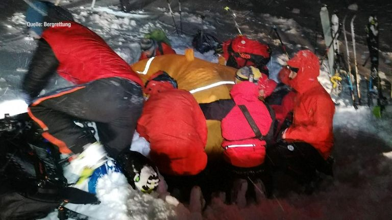 Mountain rescue put a cover over the man to help warm him up after they found him buried in the snow. Pic: Bergrettung