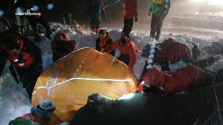 The rescuers battled snow storms to find the buried man. Pic: Bergrettung