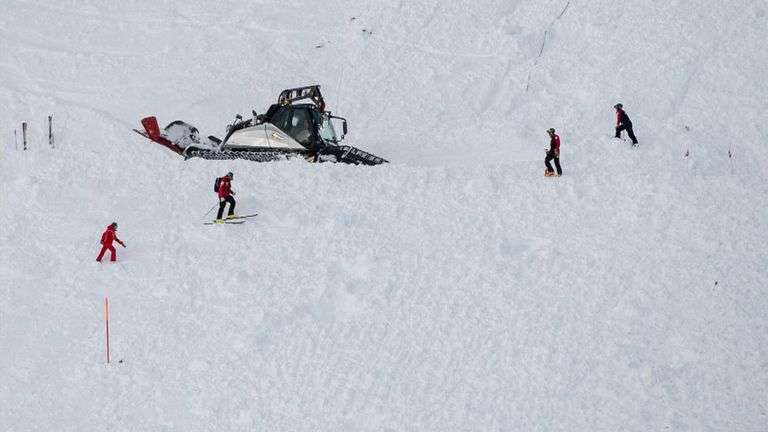 Rescue workers scoured the snow in Andermatt for people trapped underneath