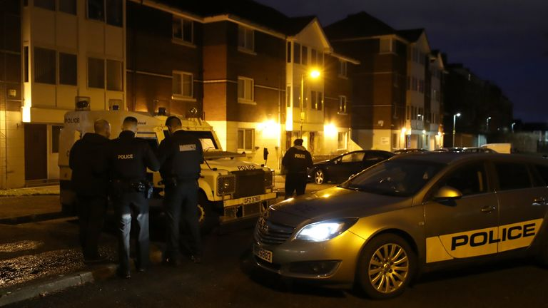 Police at Kinnaird Close in Belfast, after the bodies of a man and a woman were found in an apartment