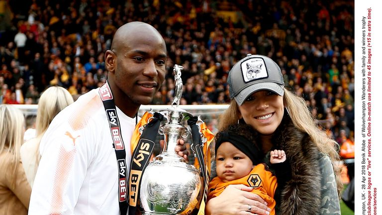 Benik Afobe pictured celebrating Wolves' promotion in 2018 with his partner and daughter