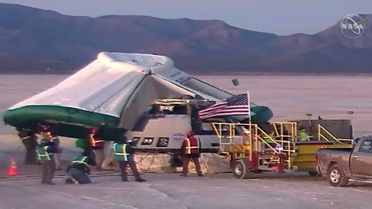 A tent is placed over the Starliner. Pic: NASA TV