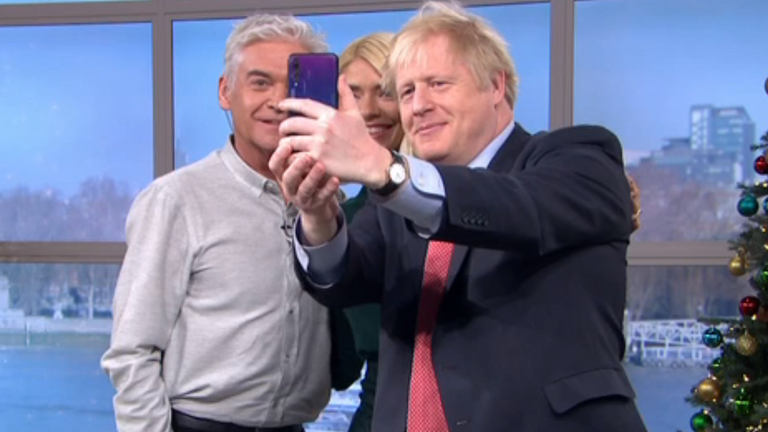 Boris Johnson was spotted using a Huawei phone to take a selfie with Phillip Schofield and Holly Willoughby