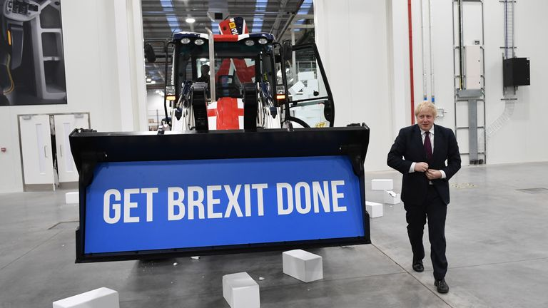 "Boris Johnson leaves after driving a Union flag JCB through a fake wall with the word ""Gridlock"""