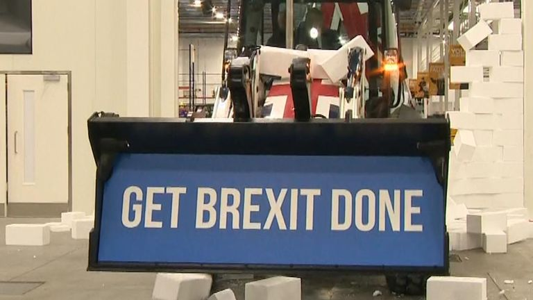 Boris Johnson drives through foam wall with Brexit message
