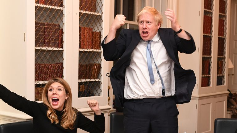 Boris Johnson and his girlfriend Carrie Symonds celebrate a Tory win in No 10 on election night. Pic: Andrew Parsons