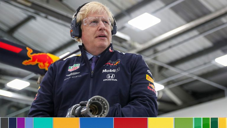 MILTON KEYNES, UNITED KINGDOM - DECEMBER 4:  Britain's Prime Minister Boris Johnson prepares to change the wheel on a Formula One car during his visit to Red Bull Racing, as he resumes election campaigning, on December 4, 2019 in Milton Keynes, England. The UK will go to the polls on December 12, the third General Election in less than five years.  (Photo by Hannah McKay-WPA Pool/Getty Images)