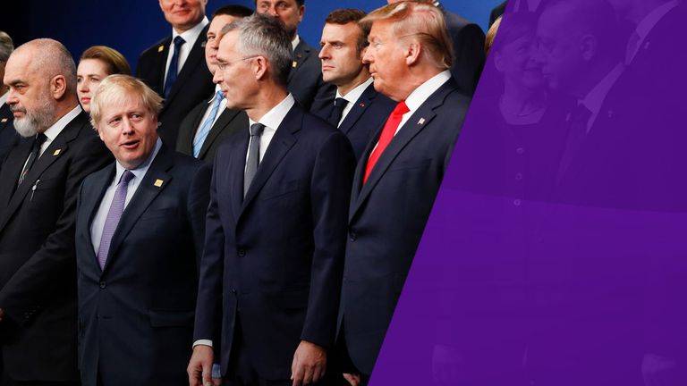 Boris Johnson stands next to NATO Secretary General Jens Stoltenberg and US President Donald Trump at the NATO summit in London