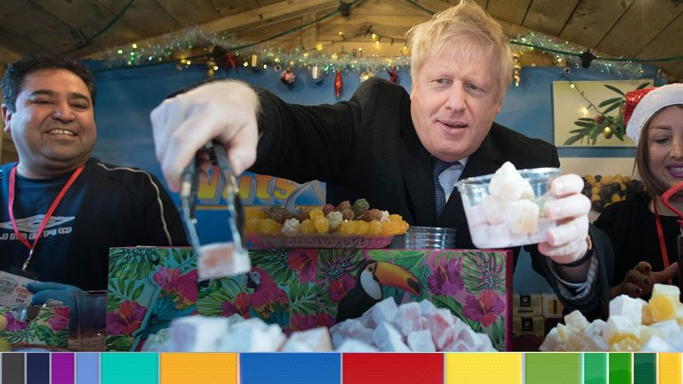 Boris Johnson picks out Turkish delight during a campaign visit to Salisbury, Wiltshire