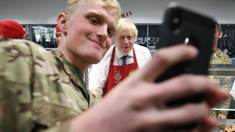 A solider snaps a selfie with the prime minister