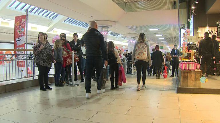 Shoppers queue outside a store in Gateshead Boxing Day 2019