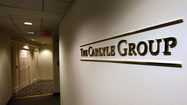 A sign for the Carlyle Group, a private equity firm
