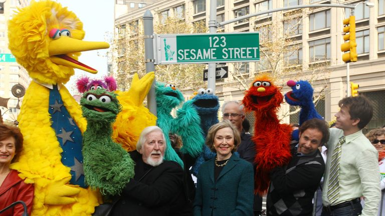 Sesame Street co-founder Joan Ganz Cooney (centre) paid tribute to Spinney's 'countless' contributions