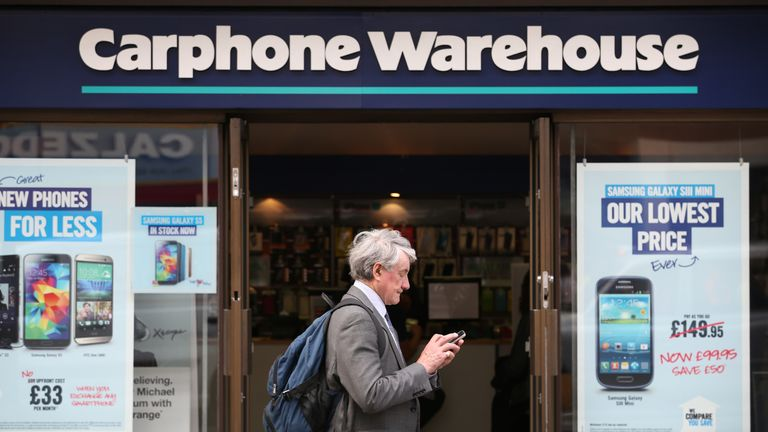 at a branch of Carphone Warehouse on May 15, 2014 in London, England. Dixons Retail the parent group of PC World and Currys have announced a ..3.8 bn merger with mobile phone retailer Carphone Warehouse.