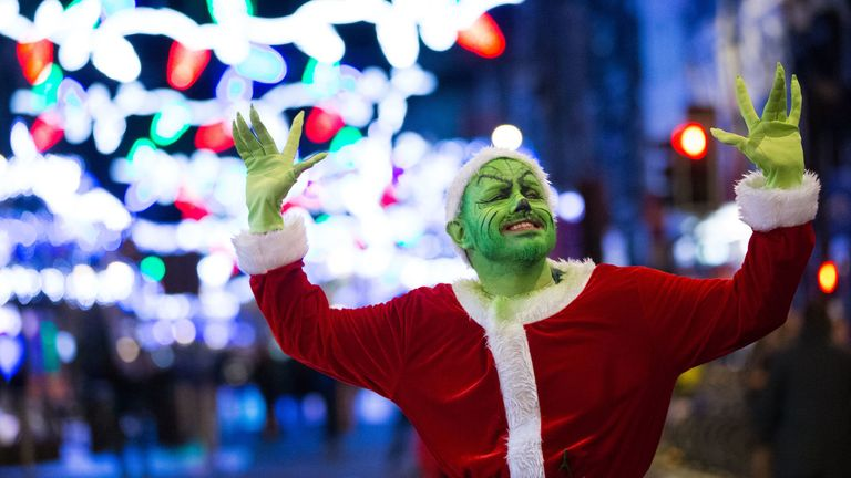 The Grinch makes an appearance in Cardiff as revellers make the most of the celebrations on the last Friday before Christmas
