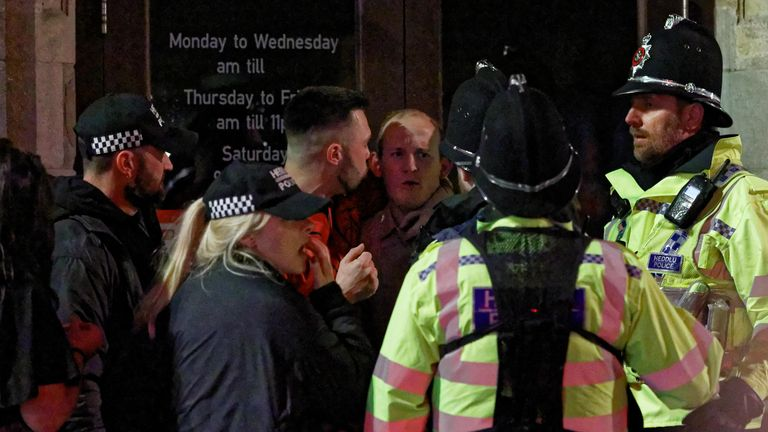 Two men are spoken to by police officers on the last Friday before Christmas IN SWANSEA