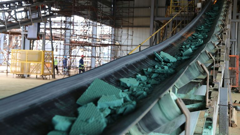A conveyor belt carries chunks of raw cobalt after a first transformation at a plant in Lubumbashi, Congo