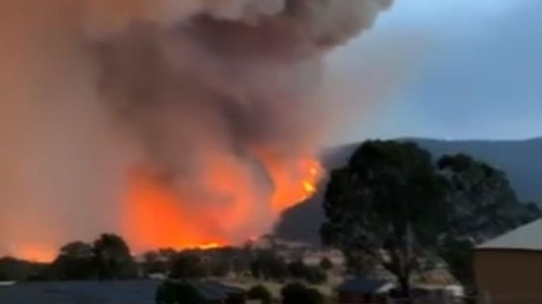 Bushfires threatening the town of Corryong, Victoria, glowed orange in the hills surrounding the municipality on December 31. Pic: Brooke Whitehead via Storyful