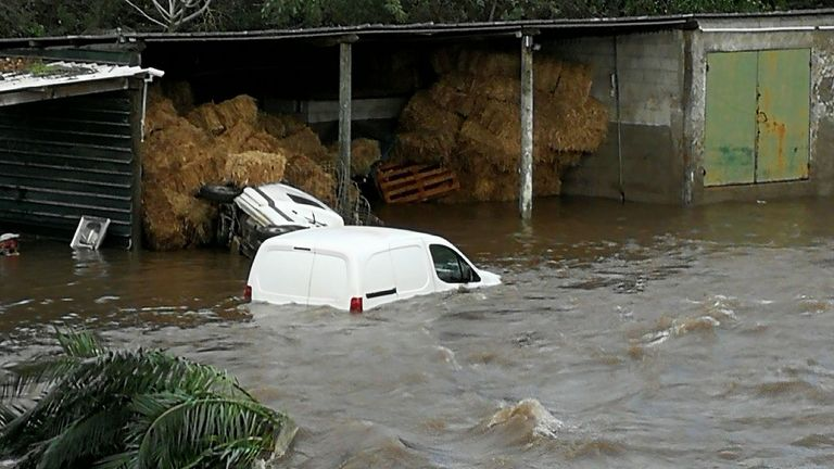 Cars are engulfed in water in Porticcio after heavy rainfalls hit south Corsica