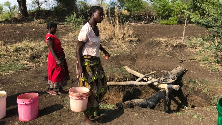 People struggle to find water to grow crops during the Zambian drought