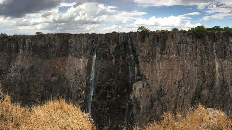 A trickle of water comes over the usually mighty Victoria Falls