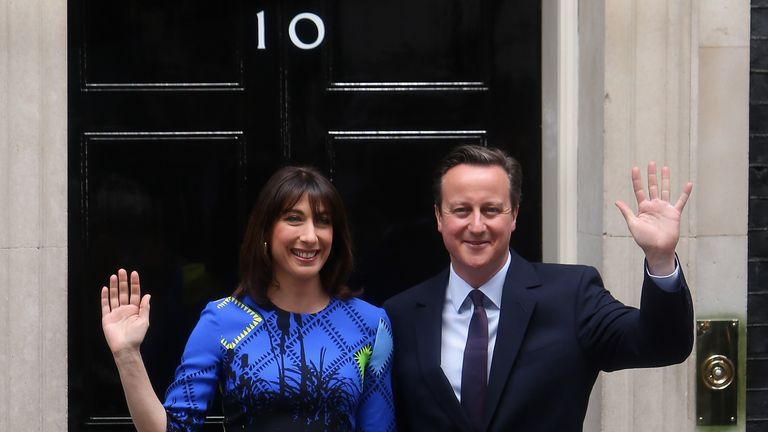 British Prime Minister David Cameron in Downing Street with his wife Samantha