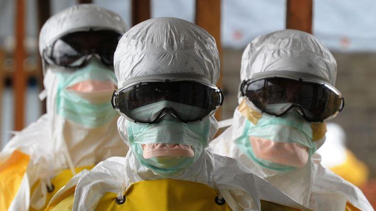 Health care workers leave an Ebola-risk area in Monrovia, Liberia
