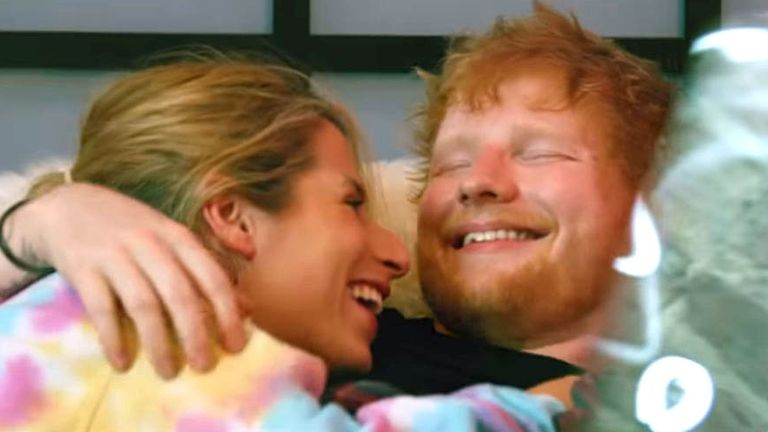 Ed Sheeran and his wife cosy up in the singer's latest music video Put It All On Me. Pic: Ed Sheeran