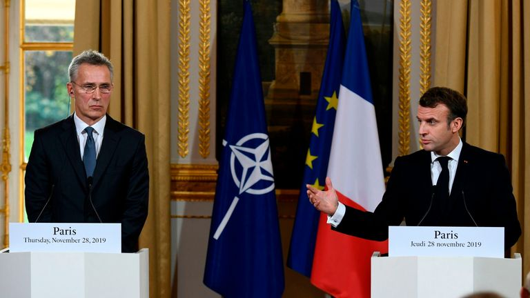 French President Emmanuel Macron (R) and NATO Secretary General Jens Stoltenberg