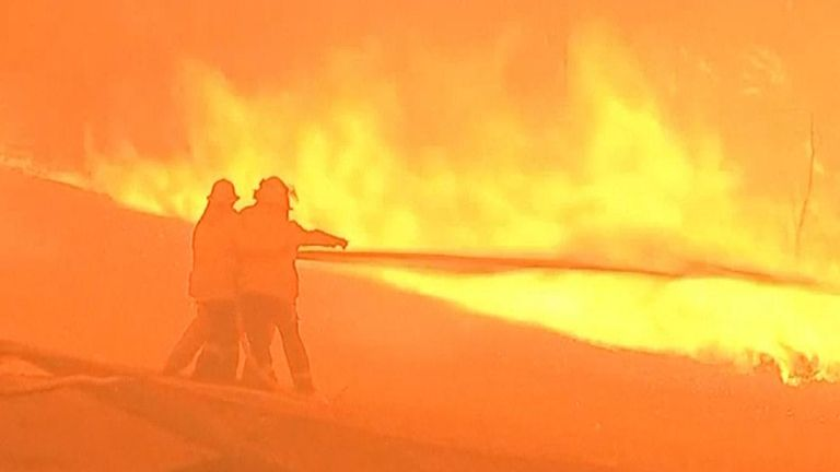 Firefighters battle against a raging blaze in New South Wales
