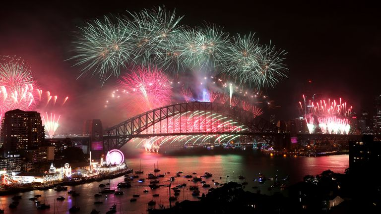 The water lights up with colour as Sydney Celebrates New Year's Eve