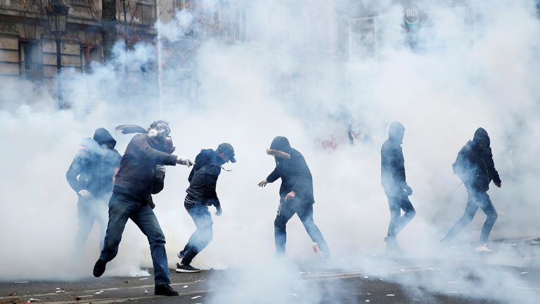 Protesters are tear gassed during clashes with police